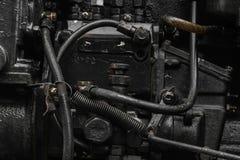 Superfície do fundo do motor velho, preto e oleoso da máquina fotografia de stock royalty free