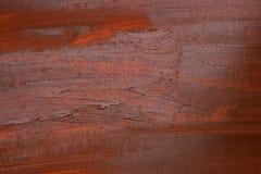 Superfície pintada com pintura vermelha com manchas e borrões imagem de stock