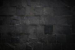 A superfície preta da parede usa muitos tijolos Ou teste padrão preto velho do sumário da parede de tijolo Fundo escuro belamente imagens de stock royalty free