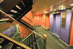 Superfast Ship Interior. Interior of  Superfast  ship, reflective surfaces, stairways and hall. The Superfast ships operate in international waters, offering Stock Photos
