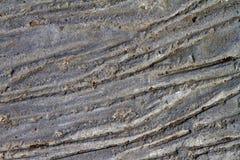 Superficie altamente dettagliata approssimativa concreta grigia per usando come la struttura o fondo di pietra fotografia stock