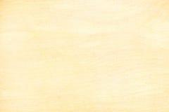Superficie amarilla del tablero de la madera contrachapada para el fondo con el modelo natural Foto de archivo