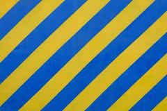 Superficie azul y amarilla del Grunge como modelo de la advertencia o del peligro Foto de archivo