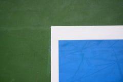 Superficie azul y verde del campo de tenis Imagen de archivo
