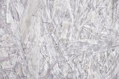 Superficie bianca del bordo del filo Fondo grigio chiaro del truciolato Immagine Stock
