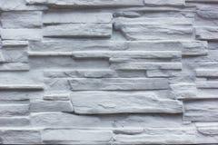 Superficie blanca decorativa de la pared de piedra de la pizarra Foto de archivo