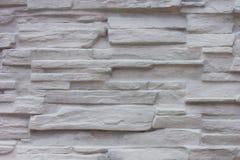 Superficie blanca decorativa de la pared de piedra de la pizarra Imágenes de archivo libres de regalías