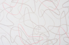 Superficie blanca del modelo del bumerán del fondo foto de archivo libre de regalías
