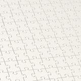 Superficie coperta di pezzi di puzzle Immagini Stock Libere da Diritti