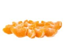 Superficie cubierta con las secciones de la rebanada de la mandarina Foto de archivo libre de regalías