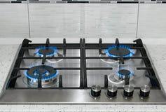 Superficie de acero inoxidable de la cocina con la llama del gas de las hornillas fotografía de archivo libre de regalías