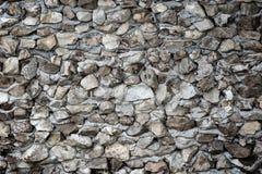 Superficie de la pared de piedra con el fondo del cemento Imagen de archivo libre de regalías