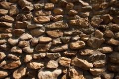 Superficie de la pared de piedra del vintage con el cemento Pared de piedra vieja del primer Fotografía de archivo