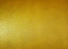 Superficie de la textura amarilla de la piel sintética como fondo Fotos de archivo libres de regalías