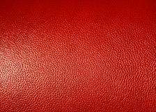 Superficie de la textura roja de la piel sintética como fondo Imagen de archivo
