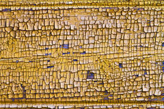 Superficie de madera agrietada amarilla, fondo Foto de archivo libre de regalías