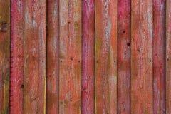 Superficie de madera roja y rosada hecha de tableros trenzados Fotografía de archivo libre de regalías