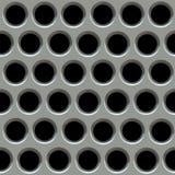 Superficie de metal con los agujeros. Fotos de archivo libres de regalías