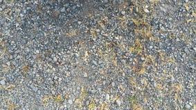 Superficie de tierra del fondo de la textura de la grava áspera gris Fotos de archivo libres de regalías