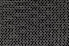 Superficie del fondo di tessuto grigio con i piccoli fori neri su  Fotografia Stock