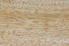 Superficie del primo piano leggero del bordo di legno, struttura, fondo immagini stock