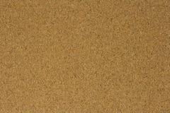 Superficie del tablero marrón del corcho para el fondo Fotografía de archivo libre de regalías