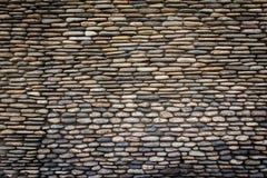 Superficie della parete di pietra con cemento Immagini Stock