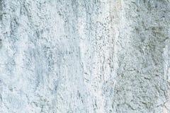Superficie della parete di pietra incrinata, struttura del muro di cemento Fotografie Stock