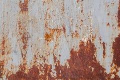Superficie di ferro arrugginito con i resti di vecchia pittura, struttura grigia, fondo Fotografia Stock Libera da Diritti