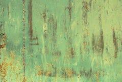 Superficie di ferro arrugginito con i resti di vecchio fondo della pittura Fotografie Stock Libere da Diritti