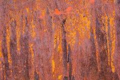 Superficie di ferro arrugginito con i resti di vecchio fondo di struttura della pittura Fotografie Stock Libere da Diritti