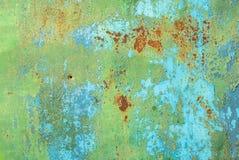 Superficie di ferro arrugginito con i resti di vecchio fondo di struttura della pittura Immagini Stock
