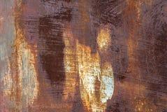 Superficie di ferro arrugginito con i resti di vecchio fondo di struttura della pittura Immagini Stock Libere da Diritti