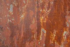 Superficie di ferro arrugginito con i resti di vecchia pittura, fondo di struttura Fotografia Stock Libera da Diritti