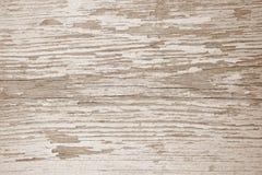 Superficie di legno con le crepe e la pelatura della pittura bianca fotografia stock