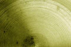 Superficie di metallo con i graffi nel tono giallo Fotografie Stock Libere da Diritti