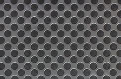 Superficie di metallo grigia con i cerchi neri Fotografia Stock