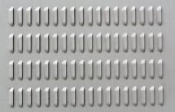 Superficie di metallo grigia di colore con i fori di ventilazione Fotografia Stock