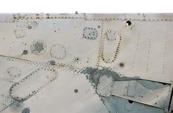 Superficie di metallo isolata degli aerei con alluminio ed i ribattini Fotografia Stock