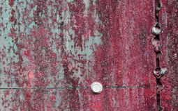 Superficie di metallo rossa graffiata ed arrugginita Fotografia Stock