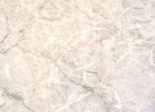 Superficie di pietra di marmo beige della luce naturale per il bagno o la cucina Fotografia Stock