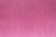 Superficie di plastica rosa del fondo con il modello dei quadrati immagini stock