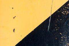 Superficie dipinta nel nero e nel giallo Fotografia Stock