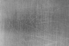 Superficie grigia dell'acciaio, fondo spazzolato del metallo con le tracce di expl Immagine Stock Libera da Diritti