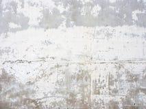 Superficie intonacata luminosa della parete con le piccole crepe Fotografia Stock Libera da Diritti