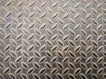 Superficie metálica sucia con el modelo de la placa del diamante Imagen de archivo