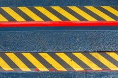 Superficie negra y amarilla del Grunge de las rayas como la advertencia o peligro Pat Foto de archivo libre de regalías