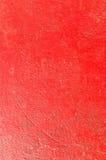Superficie rossa di danno di pittura della parete Fotografia Stock