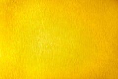 Superficie vac?a brillante del metal de oro, fondo met?lico brillante amarillo, cierre del contexto de la hoja del oro para arrib imagen de archivo