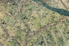 Superficie verde de la gema del amazonite Textura verde de la piedra preciosa de la bobina fotos de archivo